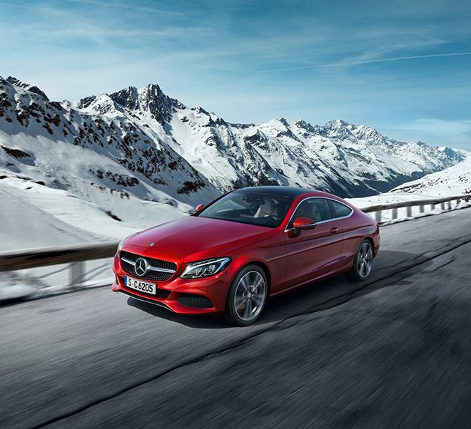 The new Mercedes-Benz C-Class Coupé (C 205) on its way in the snowy mountians.