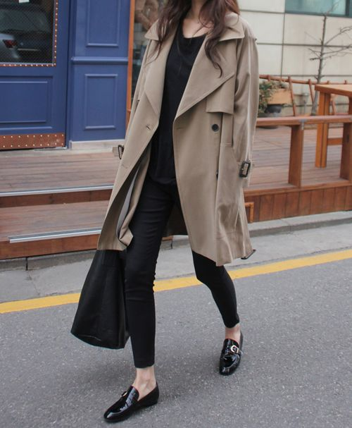 City chic from Death by Elocution. Taupe trench with black basics, cropped pants, loafers.