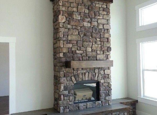 Fireplace: Villa Stone (Color: Apache) manufactured stone veneer by Kodiak Mountain Stone