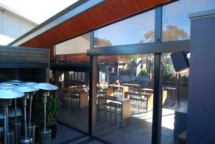 Clear vertical screens, fixed panels and full length retracting panels keep out cold, rain, wind and sound!