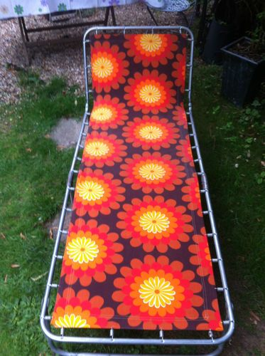 vintage sun lounger. Reminds me of caravan holidays.