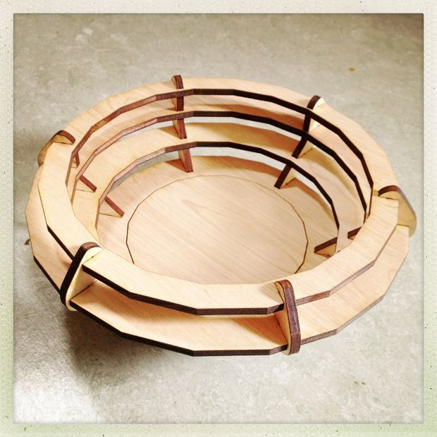 Laser cut bowl in cardboard and wood.
