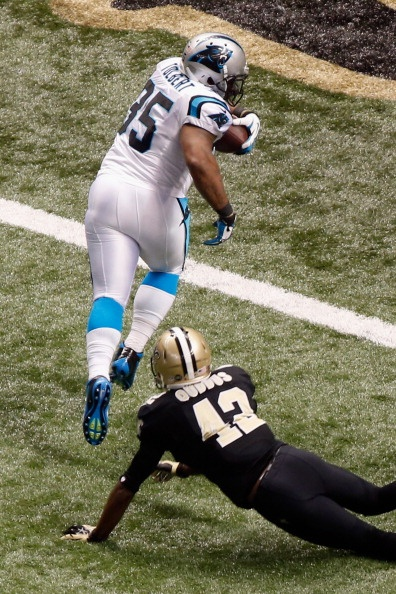 NEW ORLEANS, LA - DECEMBER 30: Mike Tolbert #35 of the Carolina Panthers scores a touchdown over Isa Abdul-Quddus #42 of the New Orleans Saints at the Mercedes-Benz Superdome on December 30, 2012 in New Orleans, Louisiana. (Photo by Chris Graythen/Getty Images)