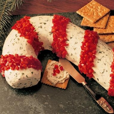 Candy Cane Cheese Spread....I like the idea not necessarily the recipe.  You could use ham, pepperoni or anything red for the stripes.  They used red bell pepper
