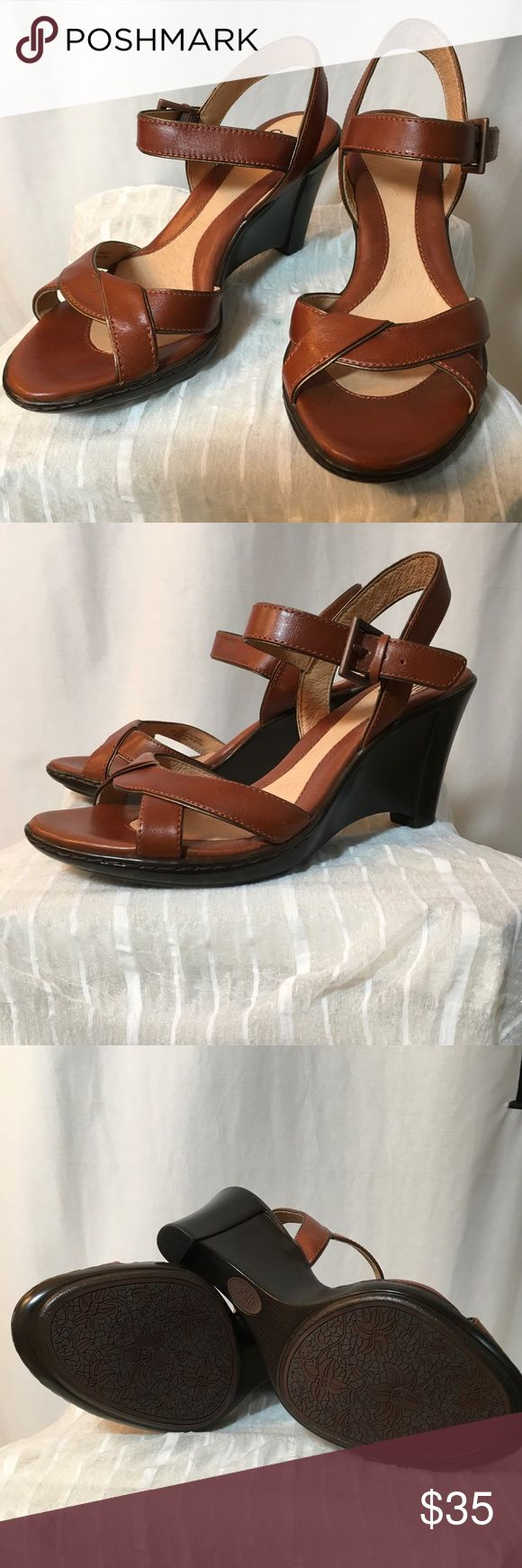 "Sofft Brand Cognac Leather Wedges Never Worn Never worn! This is a beautiful pair of wedge sandals in a classic cognac leather. Sofft is famous for their comfortable foot beds; in the words of the company, ""comfort without compromising style."" Scratch on underside of one shoe (see 4th picture,) small spot on one footbed (5th picture,) and small stain on inside of one ankle strap. None of these are apparent when shoes are worn. Step out in comfort! Sofft Shoes Wedges"