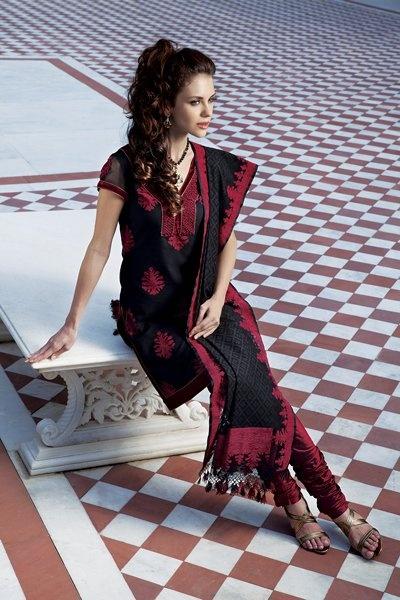 Banarasi Jute net kurta, embellished with thread work, along with pure silk churidar. Priced at $359.