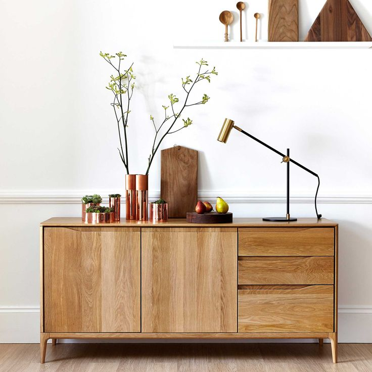 The Ercol Romana sideboard features fluid wave-shaped recesses, a signature detail of the range.
