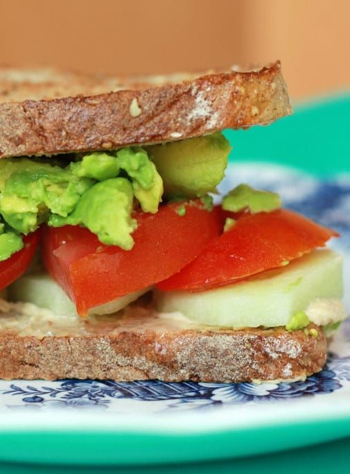Tomato, Avocado, Cucumber, and Hummus Sandwich on Toasted Sourdough