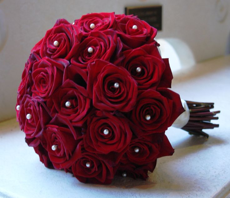 Minus the horrible pearls, I love the classic tight red rose bouquet!
