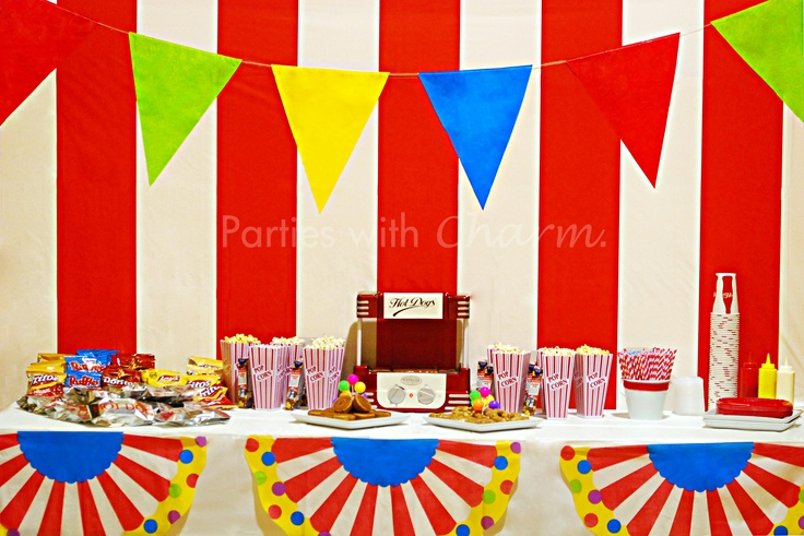 Carnival Party Concession Stand featuring Nostalgia 50's Style Hot Dog Roller.  The menu included hot dogs, corn dogs, butter & white cheddar cheese popcorn, Cracker Jacks, pretzels, spinwheels, cupcakes and of course candy!!!