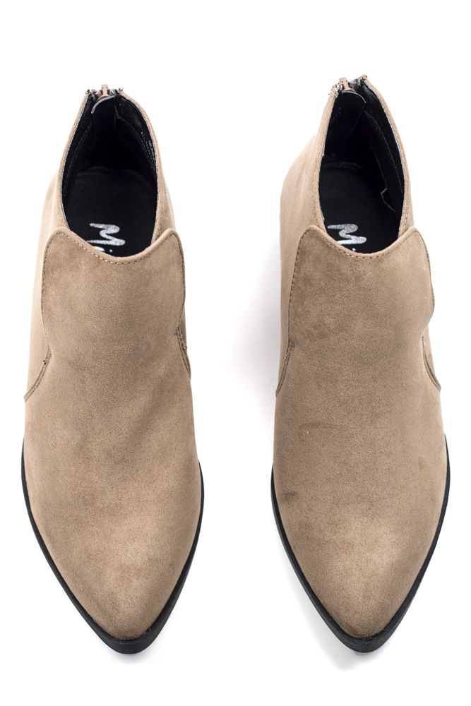 The Lila Booties are short and extra sweet. Add their neutral tone and  sleek pointy toe to practically any look.