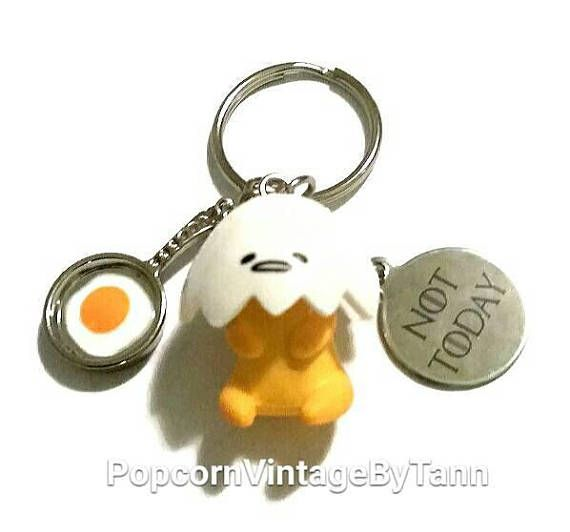 Check out this item in my Etsy shop https://www.etsy.com/ca/listing/545668528/kawaii-gudetama-keychain-lazy-egg-key