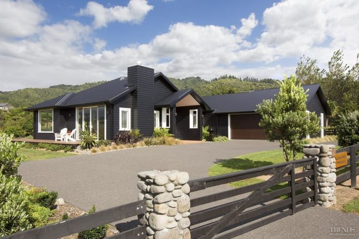 Award-winning country home with black cladding