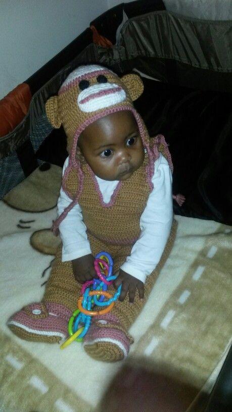 My pumpkin in her crochet set. Baby jumpsuit, booties, and sock monkey crochet set.