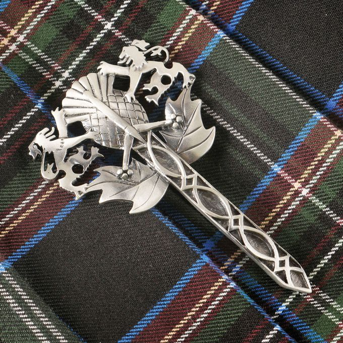 "Scottish Kilt Pin.  This pin masterly combines three of the most iconic symbols of Scotland – Rampant Lion, Thistle and Claymore Sword. Crafted of lead-free pewter with a sterling silver overlay. Attention getting and a bold look for kilts or jacket collars. 4""L x 2 ¼""W. Imported."