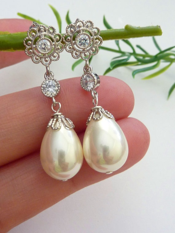 Cream Ivory Teardrop Pearl with White Gold Plated Cubic Zirconia Round Drop and CZ Flower Post Earrings. $38.00, via Etsy.