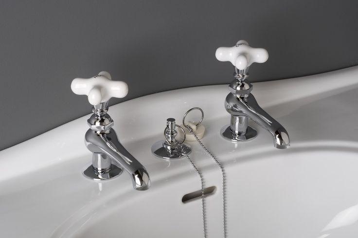 Antiquestyle faucet set with allporcelain cross handles