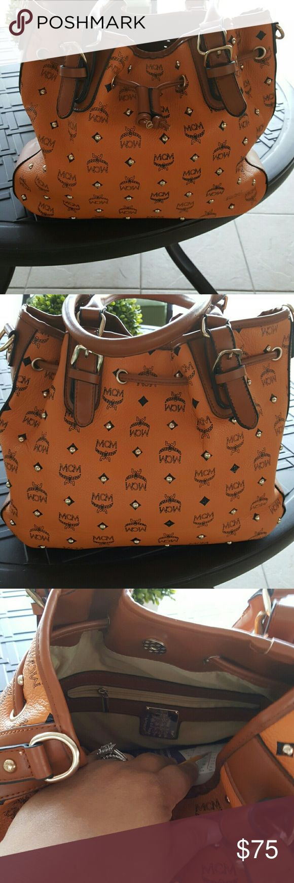 Mcm handbag Cognac in color with rivets drawstring bag. I don't have the long strap that goes with it. In great shape. Bags Totes