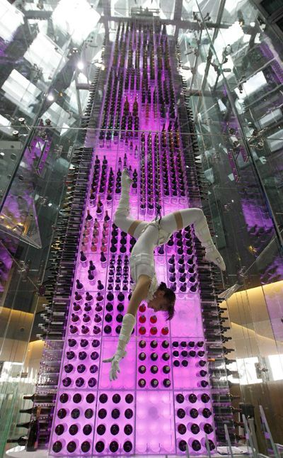 Wine angels at Aureole in Las Vegas/Mandalay Bay. Aureole Restaurant in Las Vegas features a unique wine tower.  Aureole's visual trademark is a four-story wine tower with its very own Wine Angel Stewards, who gracefully ascend the tower to retrieve bottles. Guests can search the 3,200 bottle touch-screen wine list, which includes a 1961 bottle of Chateau Petrus valued at $4,500.