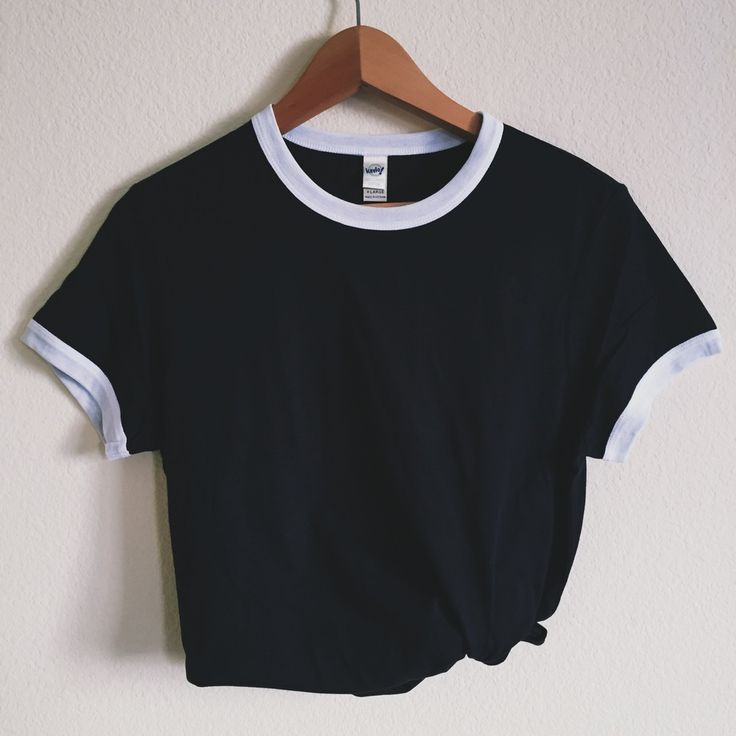 This classic black and white ringer tee is essential to your collection.  Our ringer tees are a staple to any girl's closet, adding a touch of  grunge. They look great styled casually with jeans and boots, or dressed up  with a cute plaid skirt.  More sizing and composition infohere.
