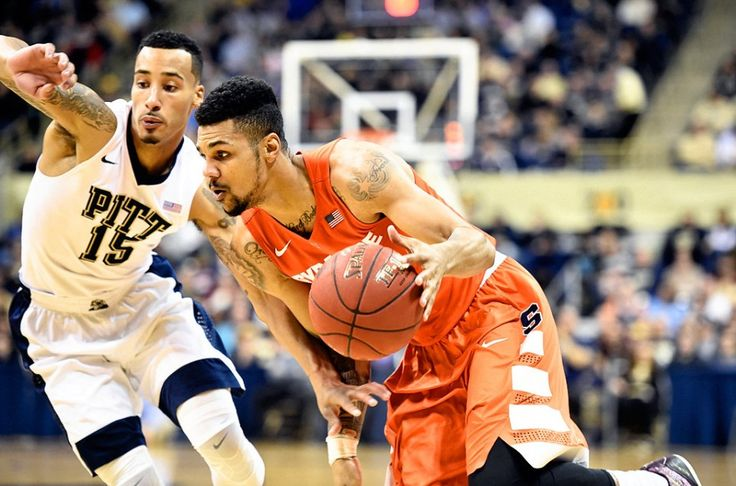 Syracuse University forward Michael Gbinije (0) tries to penetrate the Pitt defense in the second half of the Syracuse-Pitt game at the Petersen Events Center. Dec. 30, 2015. Dennis Nett | dnett@syracuse.com