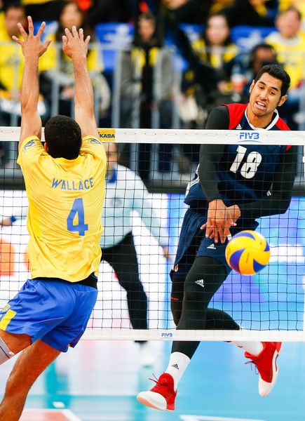 Wallace De Souza Photos Photos - Garrett Muagututia #18 of the United States spikes the ball against Wallace de Souza during the semifinal match between Brazil and United States at Arena da Baixada Stadium during day four of the FIVB World League 2017 - Group 1 Final, on July 07, 2017 in Curitiba, Brazil. - FIVB World League 2017 - Group 1 Final - Day 4