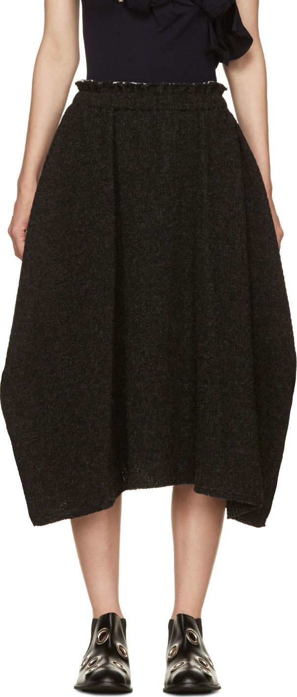 Thick-knit wool skirt in charcoal grey. Raw edges at hem and elasticized waistband. Folds at side seams concealing pockets. Unlined. Tonal stitching. CDG