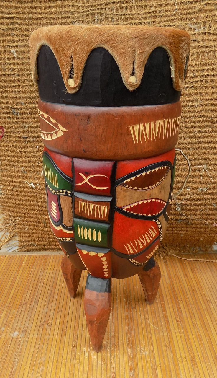"An Original "" Bongo "" drum from Mozambique. The Bongo is one of West Africa's best known instruments. This Bongo drum is traditionally carved from a single piece of Mahogany wood and topped with an Nguni cow skin as a drum head."