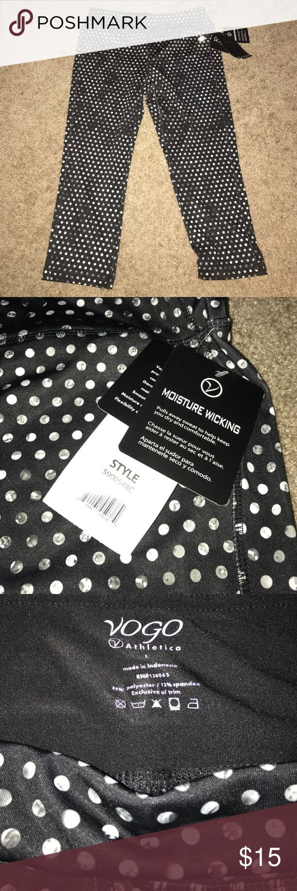 Black workout pants with white polka dots Never worn black workout pants with white polka dots. VOGO Athletica. 88% polyester/ 12% spandex Pants Track Pants & Joggers