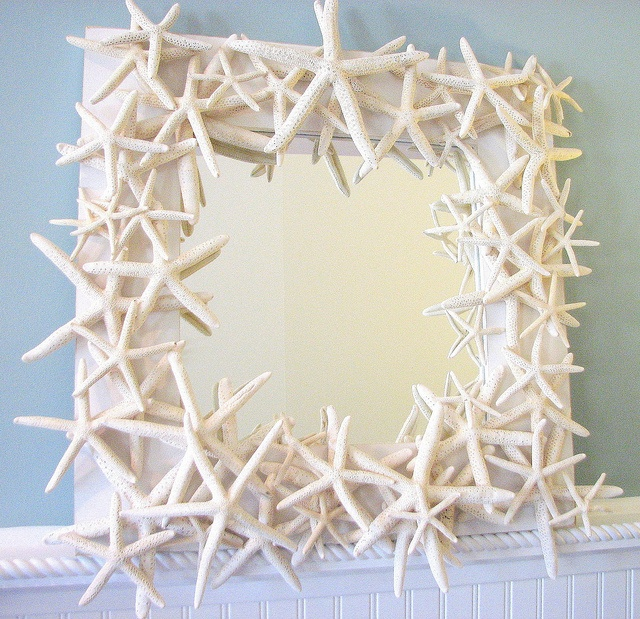 "Wasn't sure if this belonged under home or art which is what I loved about it....""Starfish mirror, artisan handmade, elegant and unique, featuring dozens of brilliant white finger starfish in delightfully random arrangement. """