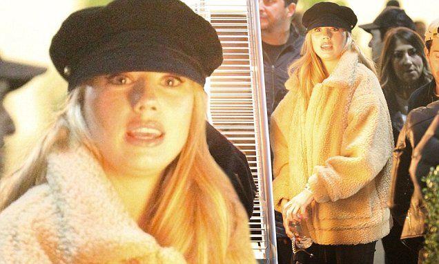 Busty blonde Charlotte Mckinney in furry jacket outside Jay-Z concert