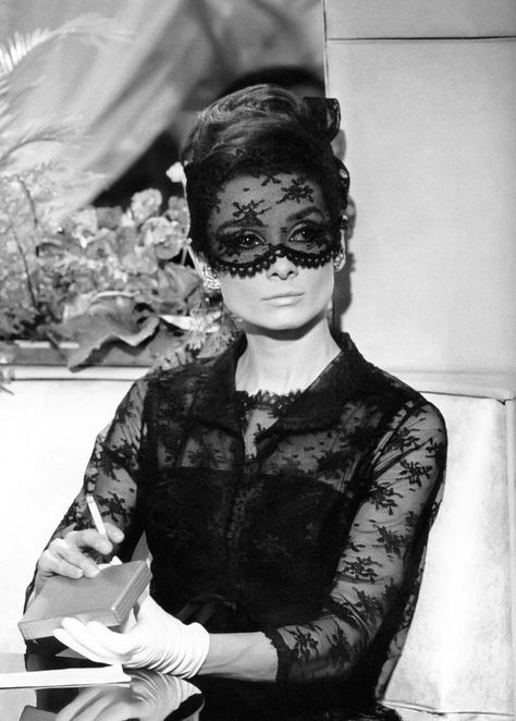 Audrey Hepburn in Chantilly lace mask and dress designed by Givenchy in How to Steal a Million