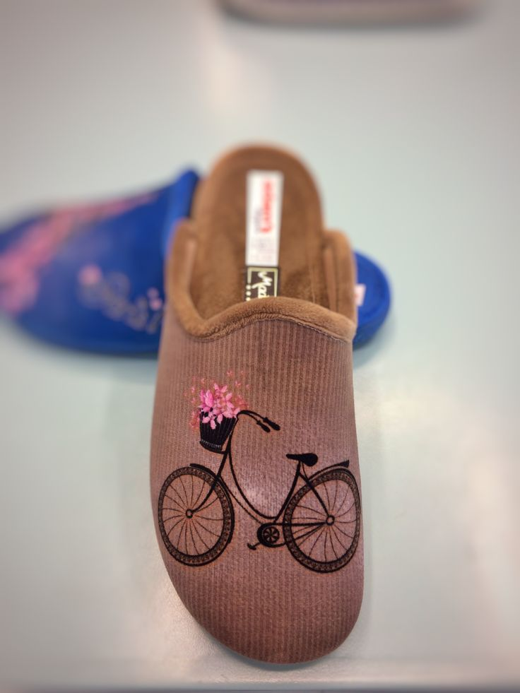 """Life is like riding a bicycle. To keep your balance, you must keep moving."" Women winter slippers 