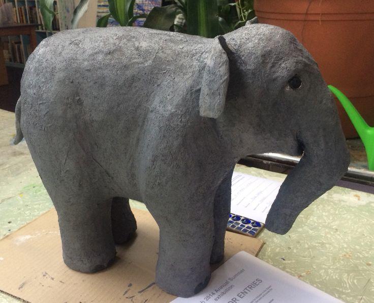 Paper mâché baby elephant.