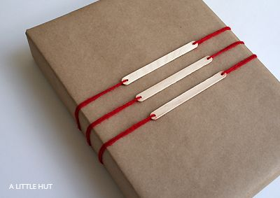 Popsicle stick gift tags. Imagine if you painted them gold or silver!