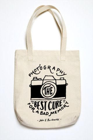 """Memories may not last forever, but photographs definitively can. Remember to never stop taking photos! """"Photography - The best cure for a bad memory"""" - John E. Burkowski quote. - 12.0 oz., 100% cotton"""