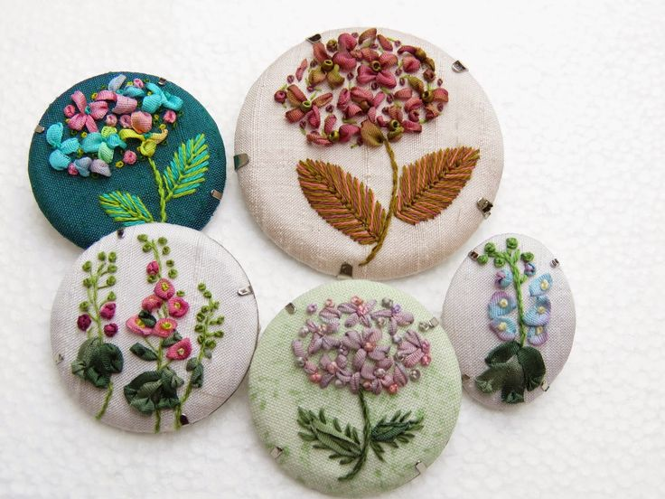 Margaret Dier Embroidery. a selection of ribbon embroidery brooches. Stitched using silk ribbons .