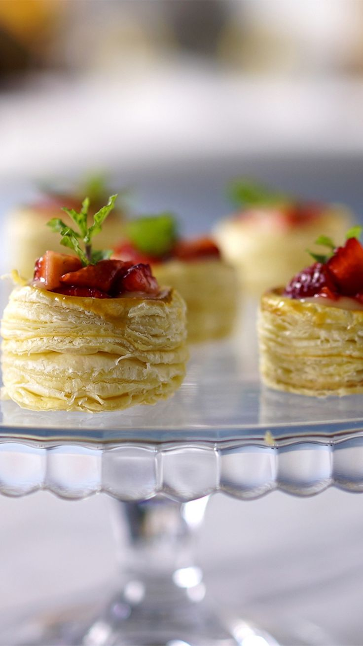 Recipe with video instructions: What's not to love about mini pastries filled with fruity deliciousness? Ingredients: 21 oz puff pastry dough, 1 egg yolk, 3 eggs, ¾ cup sugar, Juice of 3 Sicilian limes, 1 Tbsp lime zest, 3 Tbsp unsalted butter, 1 cup strawberries, chopped, Mint leaves for decoration