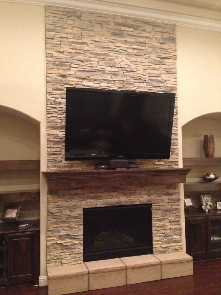 Stacked stone gas fireplace.