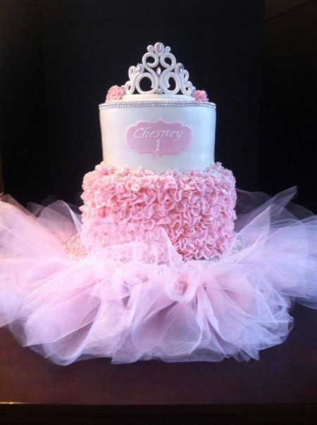 A 1st birthday cake is certainly reason to celebrate and here the girly girl theme is taken to the extreme.  See more first girl birthday party ideas at www.one-stop-party-ideas.com