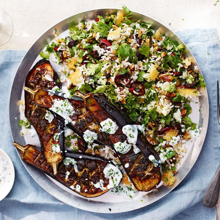 Smoky aubergine and crunchy, aromatic jewelled rice are married together with a tangy and fresh garlicy dressing.