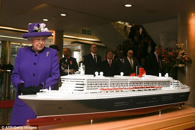 Her Majesty the Queen examines a model of the RMS Queen Mary II ocean liner at London's In...