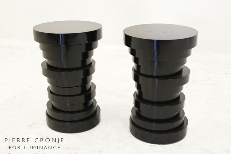 Black high gloss Comsel Ash stools designed to look like a stack of coins by Pierre Cronje for Luminance