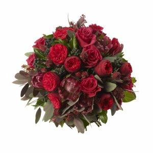 Red Proteas, Red Spray Garden Roses, Berried Ivy and Eucalyptus.