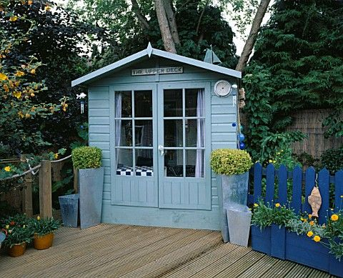THE_UPPER_DECK_TERRACE_WITH_BLUE_SUMMERHOUSE__DECKING_AND_BLUE_DECORATIVE_FENCING_ROBIN_GREEN__RALPH
