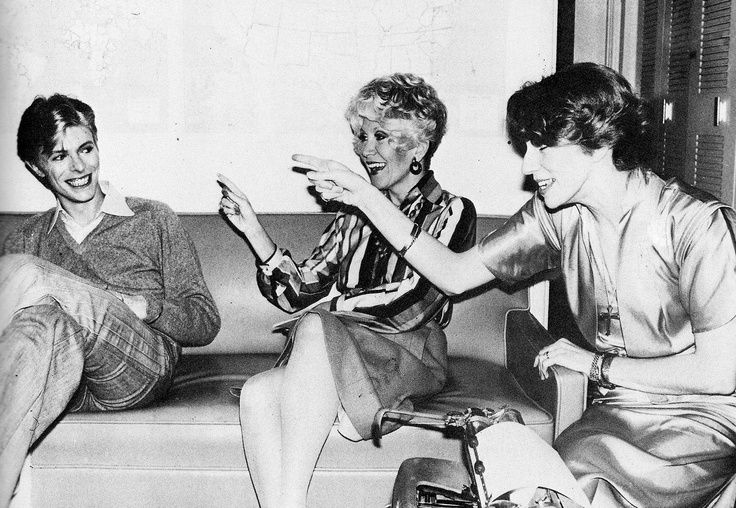 Angie Bowie and Rona Barrett pointing fingers at David.