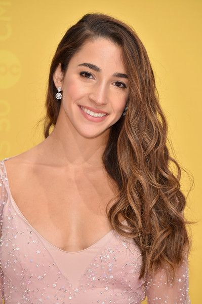 Aly Raisman Photos Photos - Olympic gymnast Aly Raisman attends the 50th annual CMA Awards at the Bridgestone Arena on November 2, 2016 in Nashville, Tennessee. - The 50th Annual CMA Awards - Arrivals