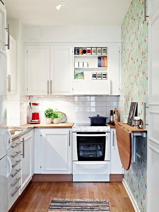 A tiny kitchen can be functional and even luxurious, add a folding table for added space.
