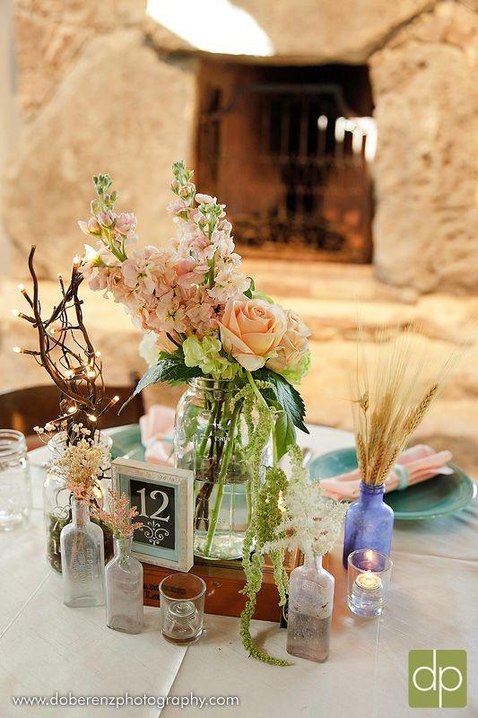 wedding vintage centerpieces with cigar boxes, mason jars, antique prescription bottles and candles...