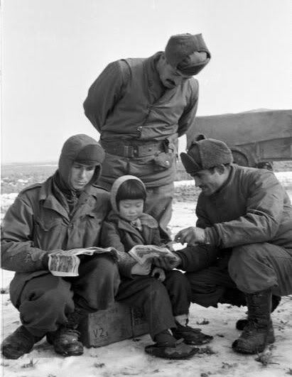 Turkish soldiers reading to a Korean girl during the Korean War